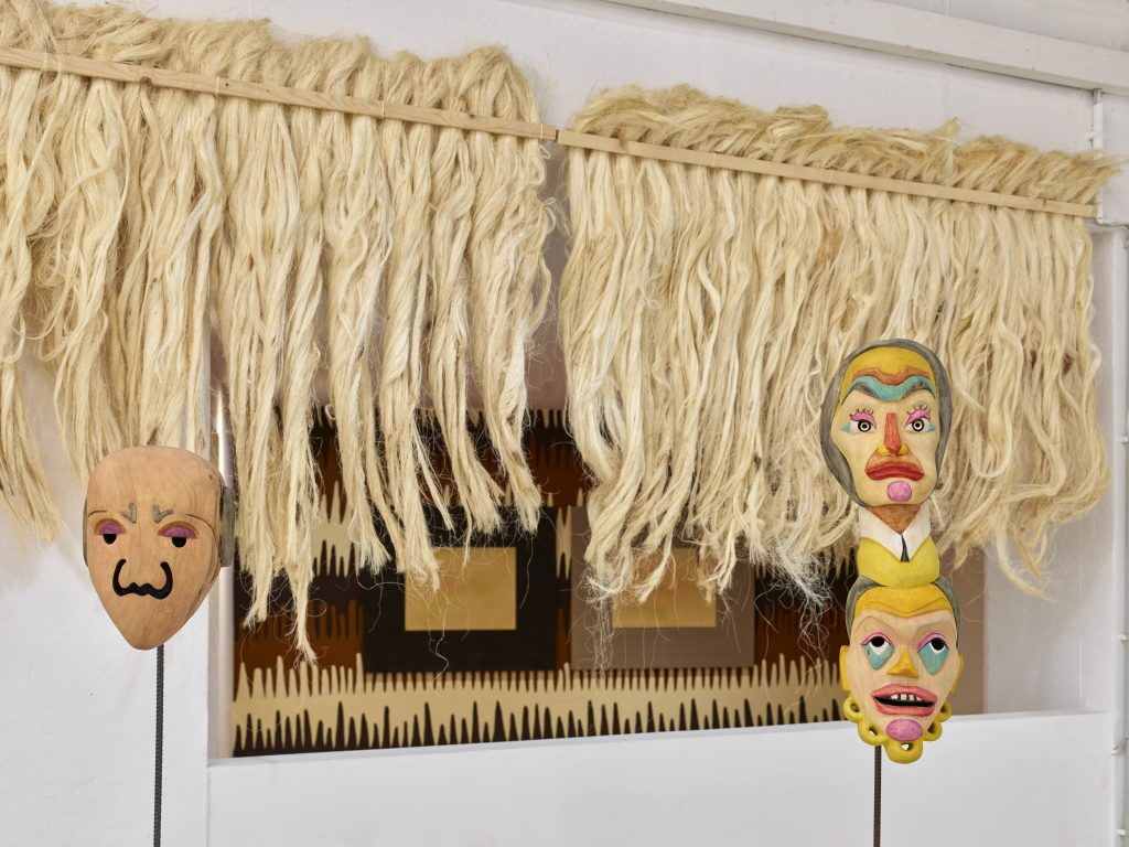 Mauricio Limon Mexican colorful wooden masks in the exhibition at wildpalms 2019